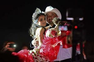 Rubi Ibarra and her father Cresencio Ibarra dance during the celebration of her 15th birthday in Villa Guadalupe on Dec 26, 2016.