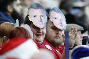 Leicester City fans with Jamie Vardy masks before the match at King Power Stadium on Dec 26, 2016.