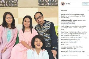 Dodi with his three children, Diona Arika Andra Putri, Dianita Gemma Dzalfayla and Zanette Kalila Azaria (in white). Two of the girls died in the maid's toilet in their Jakarta home.