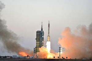 Shenzhou-11 taking off in October, carrying two astronauts who spent 30 days on board the Tiangong 2 space laboratory, which China is using to carry out experiments ahead of a plan to have a permanent manned space station.