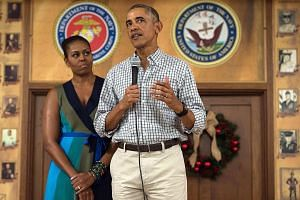 US President Barack Obama addressing troops with First Lady Michelle Obama at Marine Corps Base Hawaii in Kailua on Sunday. He is scheduled to meet Japanese Prime Minister Shinzo Abe in Hawaii.