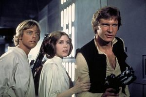 From left: Mark Hamill as Luke Skywalker, Carrie Fisher as Princess Leia and Harrison Ford as Han Solo in Star Wars: Episode IV - A New Hope.