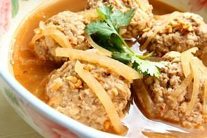 Pong tauhu, a Peranakan dish of tofu meatballs cooked in broth.