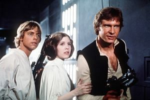 Carrie Fisher in Star Wars: Episode IV - A New Hope, with Mark Hamill and Harrison Ford.