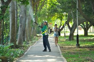 A National Environment Agency officer spraying insecticide around Block 101, Aljunied Crescent, on Sept 2. Aljunied Crescent was one of the first areas to be identified as a Zika cluster. While Zika numbers have tapered off in recent weeks - no new Z