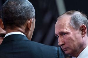 A file photo shows US President Barack Obama (left) and Russia's President Vladimir Putin talking before an economic leaders meeting.