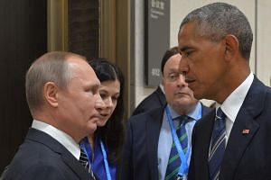 Russian President Vladimir Putin (left) with US President Barack Obama at the G-20 summit on Sept 5, 2016.