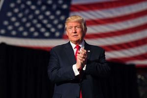 Donald Trump arrives to speak at a USA Thank You Tour 2016 at the Giant Centre on Dec 15, 2016.