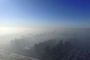Smog is seen over the city against sky during a haze day in Tianjin on Jan 2, 2017.