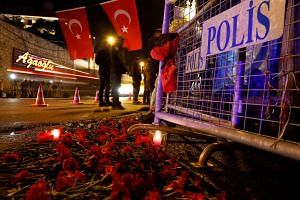 Flowers are placed in front of a police barrier near the entrance of Reina nightclub in Istanbul on Jan 1, 2017.