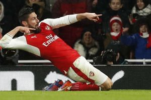 Arsenal's Olivier Giroud celebrates scoring their first goal against Crystal Palace  on Jan 1, 2017.