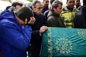 People mourning at the funeral ceremony for victim Mohamed Elhot, who was killed in the attack at the Reina nightclub in Istanbul, on Jan 3, 2017.