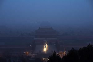 Smog cannot checkmate the passion of two chess enthusiasts who continue to hone their skills under less than ideal conditions. Conditions are also no better in Hubei province where buildings struggle to stand out amid the dense smog swirling in Xiang