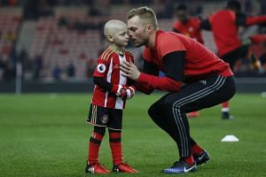 Little Bradley Lowrey gets advice from Sunderland's Sebastian Larsson before a match against Chelsea in December, 2016.
