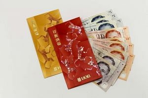 Hongbaos, or red packets, with pieces of $2, $10 and $50 notes.