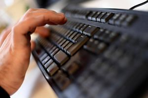 File photograph of an employee typing on a computer keyboard at the headquarters of Internet security giant Kaspersky in Moscow.