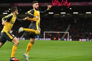 Arsenal's Olivier Giroud celebrates after scoring their third goal during the English Premier League football match between Bournemouth and Arsenal.