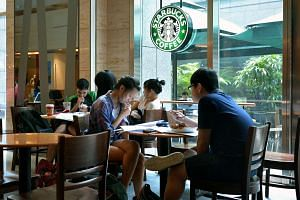 Students studying at a Starbucks outlet in City Link Mall.