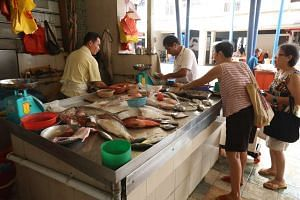 Prices of fish and prawns have skyrocketed by as much as 50 per cent ahead of Chinese New Year, and could go up even more, say fishmongers at two wet markets including one at Toa Payoh Lorong 4 (pictured).