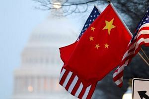 The People's Republic of China flag and the US Stars and Stripes fly along Pennsylvania Avenue near the US Capitol, on Jan 18, 2011.