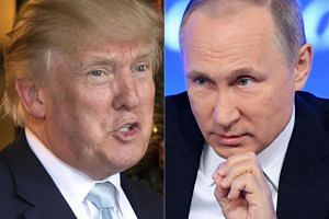 A file photo taken on Dec 28, 2016 of US President-elect Donald Trump (left) in Palm Beach, Florida; and a file photo taken on Dec 23, 2016, of Russian President Vladimir Putin speaking in Moscow.