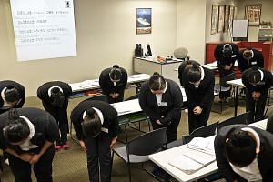 Trainees are taught to bow at a training centre in Manila, in preparation for their work as housekeepers in Japan.