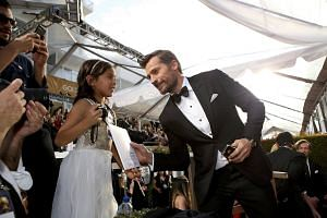 Actor Nikolaj Coster-Waldau greets a fan as he arrives at the 74th Annual Golden Globe Awards in Beverly Hills, California on Jan 8, 2017.