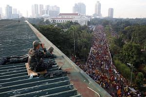 Members of Special Action Force policemen taking position as they guard the Black Nazarene religious procession in Manila, Philippines, on Jan 9, 2017.