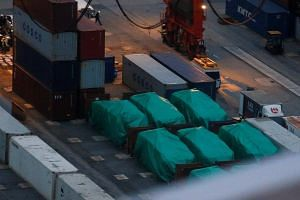 Six of the nine armoured troop carriers belonging to Singapore, from a shipment detained at a container terminal, are seen in Hong Kong on Nov 24, 2016.