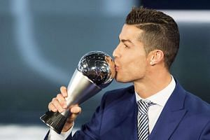 Cristiano Ronaldo kisses his trophy during the Fifa Awards 2016 gala in Zurich on Monday (Jan 9, 2017).