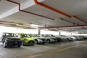 Private-hire cars at a multi-storey carpark near Beach Road, on June 15, 2016.