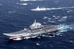 File photo of China's Liaoning aircraft carrier with accompanying fleet conducting a drill in the South China Sea in December, 2016.