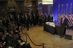 US President-elect Donald Trump holding a press conference in the lobby of Trump Tower in New York on Wednesday. With him are (from right) Vice-President-elect Mike Pence and Mr Trump's children Donald Jr, Ivanka and Eric. It was the first press conf