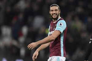 West Ham United's Andy Carroll celebrates after the game.