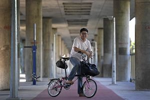 Mr Khaw, who cycles from his home in Sengkang to work in Ang Mo Kio, says he sometimes has to dodge pedestrians.