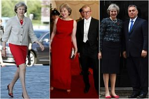 British Prime Minister Theresa May has been making a statement with her fashion choices, which includes bright colours and chic shoes.
