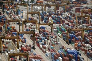 Containers are stacked up at PSA's Tanjong Pagar container terminal in Singapore, on July 24, 2015.