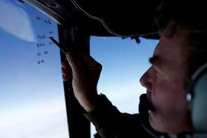 Squadron leader Brett McKenzie in a Royal New Zealand Air Force P-3K2 Orion aircraft, searching for missing Malaysian Airlines flight MH370 over the southern Indian Ocean on March 22, 2014.
