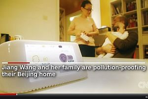 Madam Wang Jiang and her husband Ludovic Bodin have spent US$11,500 (S$16,400) on air purifiers for their home, including a device that tracks the indoor air quality.