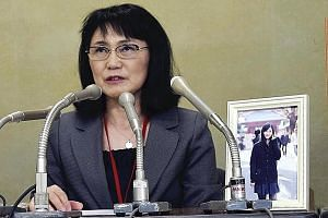 Mrs Yukimi Takahashi, who has spoken out against chronic overtime after her daughter's 2015 suicide.