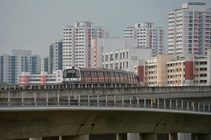 A train moving towards Jurong East MRT station.
