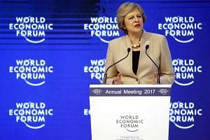 British PM Theresa May speaking at the World Economic Forum in Davos on Jan 19, 2017.