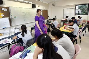 A Gujarati language lesson being conducted by Mrs Ila Shah for Secondary 3 students last Saturday. The Singapore Gujarati School holds lessons at Haig Girls' School every Saturday morning.