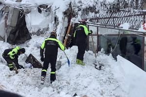 Firefighters work at Hotel Rigopiano in Farindola, central Italy, after it was hit by an avalanche, in this handout picture released on Jan 20, 2017.