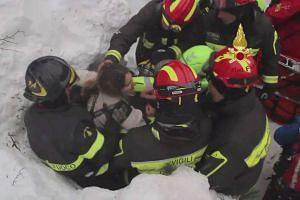 Firefighters rescue a survivor from Hotel Rigopiano.