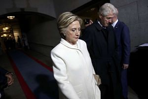 Mrs Clinton arriving at Capitol with her husband.