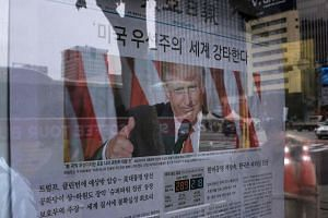 A newspaper display features Donald Trump and coverage of the US presidential elections, in Seoul, South Korea.