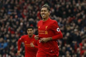 Liverpool's Roberto Firmino celebrates scoring their second goal.