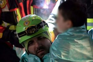 A child is rescued on Jan 20, 2017, from the Hotel Rigopiano.