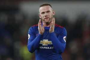 Manchester United's Wayne Rooney applauds fans after the game.